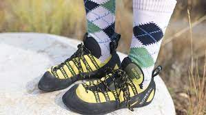 When should climbers consider wearing climbing socks